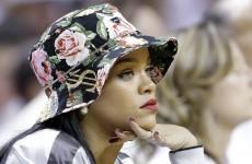 Having fun? Rihanna watches Miami Heat masterclass in how to kill a tight game