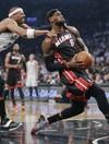 Nets cool off Heat, cut semi-final deficit to 2-1