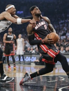 Nets cool off Heat, cut semi-final deficit to 2-1