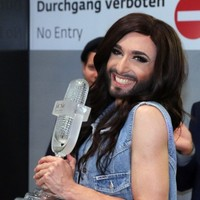 Conchita vows to fight for tolerance, as thousands turn out for Austria homecoming