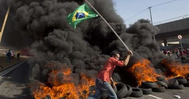 Tear gas and rubber bullets used on protesters demonstrating against Brazil World Cup