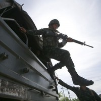 Martial law declared as armed troops take to streets of Thailand