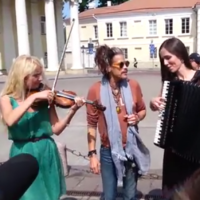 Aerosmith frontman Steven Tyler tries to sing his own song with some buskers