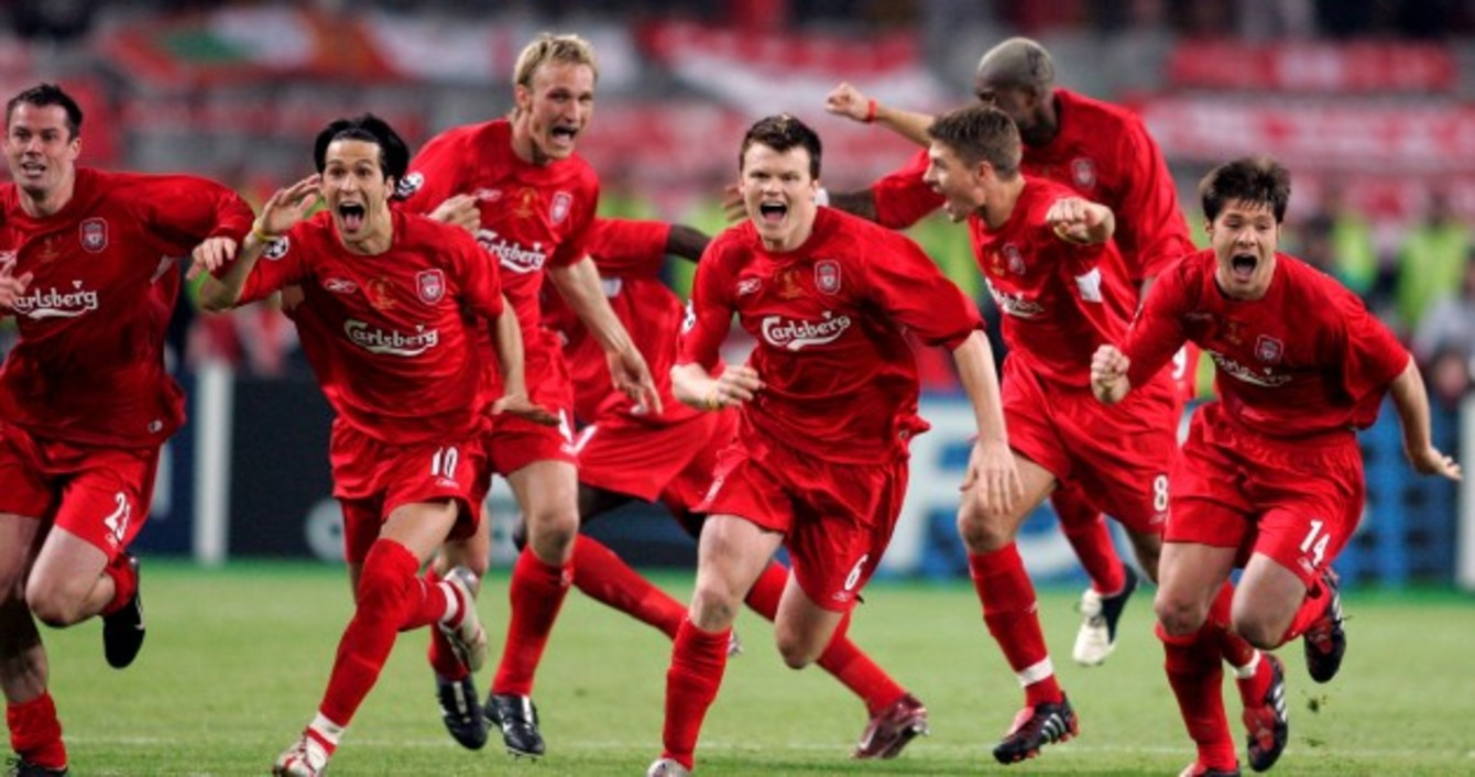 b4d52eb46 Liverpool players running to goalkeeper Jerzy Dudek to celebrate after AC  Milan s Andriy Shevchenko missed his penalty.