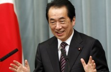 Japan's PM Naoto Kan survives no-confidence vote over handling of nuclear crisis