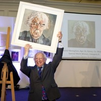 Here's President Higgins looking quite pleased with a new painting he was given