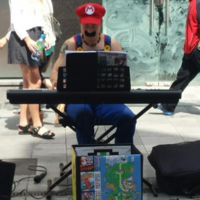 It's-a really him! Mario is busking on Henry Street