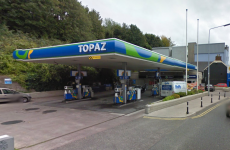 Two men charged over filling station robbery