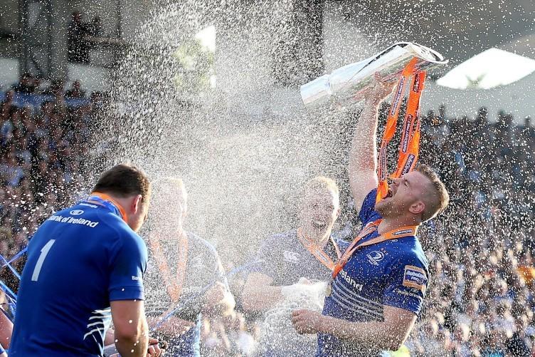 Darragh Fanning and Cian Healy spray a jubilant Jamie Heaslip.