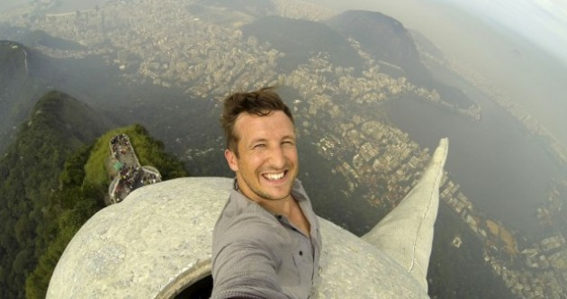 Guy takes the ultimate selfie atop Brazil's Christ The Redeemer statue