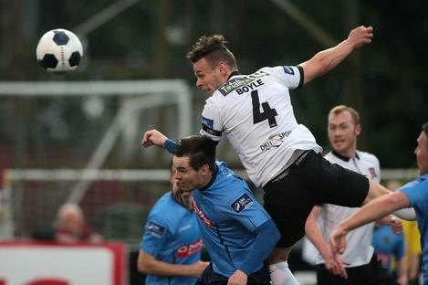 Andy Boyle heads on goal during last night's match.