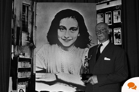Dr Otto Frank standing before an image of his daughter, Anne Frank, who died aged 15 at Bergen-Belsen concentration camp.