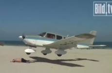 Sunbather has incredible near-miss with low-flying plane (video)