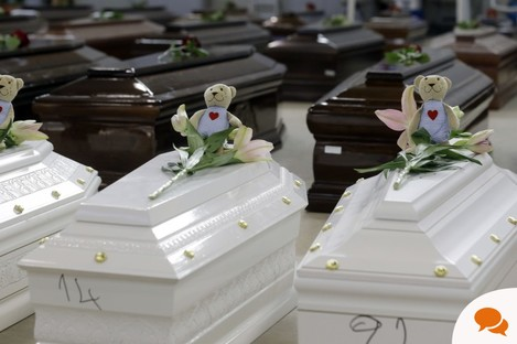 Teddy bears and flowers were placed on the coffins of children who perished in the Lampedusa tragedy, October 2013.