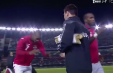Trinidad and Tobago player bows down before Messi during pre-match handshakes