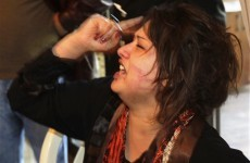 Libyan woman who claims she was raped by Gaddafi's troops arrives in Romania