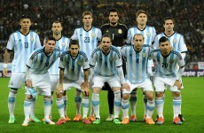 Argentina team pose with provocative Falklands banner ahead of Slovenia game
