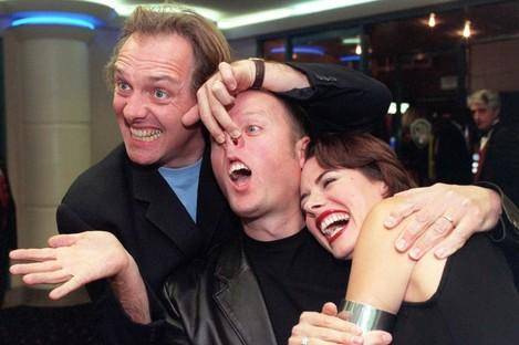 Rik Mayall, Ade Edmondson and Helen Mahieu in 1999.