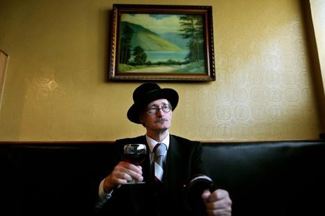 John Shevlin dressed as James Joyce in O'Loughney's bar in Dun Laoghaire Co Dublin.