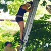 Woman climbs tree to rescue cat, has to be rescued herself