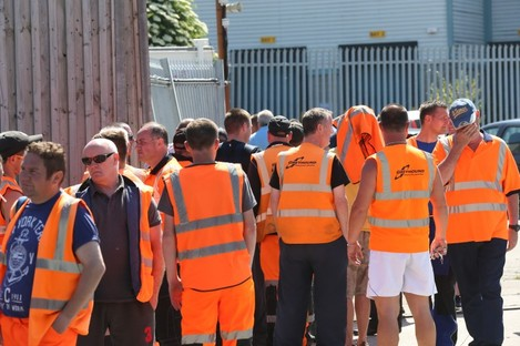 Greyhound staff outside the plant in Clondalkin earlier this week.