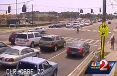 Watch this motorcyclist flip and land on his feet after crashing into a car