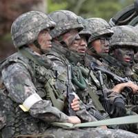 Killer soldier who shot dead five colleagues captured after tense standoff