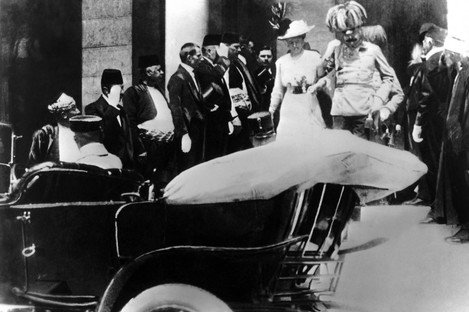 Archduke Ferdinand and his wife boarding a car just prior to their assassination in Sarajevo.