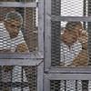 Cairo court sends three Al Jazeera journalists to jail for 7-10 years