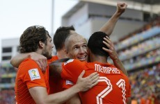 Robben inspires victory against Chile as Dutch claim top spot