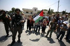 Protesters say children have attempted to block Israeli tanks in Palestinian village
