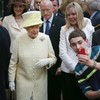 Say cheese! Kid tries to take a selfie in front of Queen Elizabeth