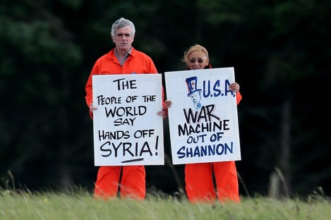 Margaretta D'Arcy and Niall Farrell attempt to block the runway of Shannon Airport in September last year