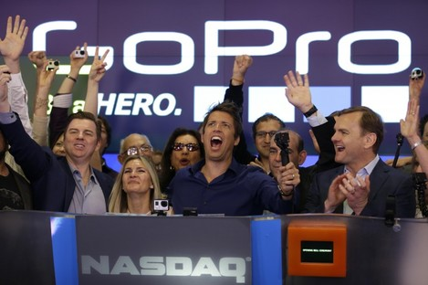 GoPro CEO Nick Woodman (centre) celebrates with his company going public.
