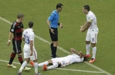 Jermaine Jones floored by referee and Good-night John Boye for Ghana