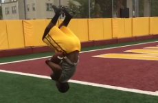 Wide receiver catches two footballs while doing a backflip