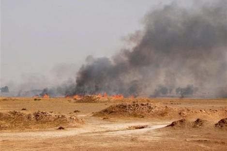 Smoke rises during a military operation to regain control of Dallah Abbas north of Baqouba, the capital of Iraq's Diyala province.