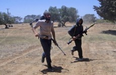 Rebels smuggle weapons from Tunisia into Libya, as Gaddafi vows to fight to death