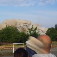 Watch this guy's incredible near-miss with a stray rock from an explosion