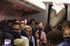 Plane's evacuation slide accidentally inflates in mid-flight... inside the cabin