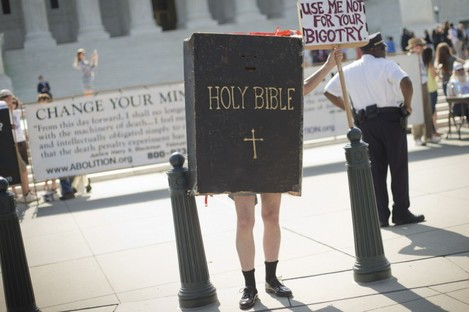 Demonstrator dressed as the 'Bible' stands outside the Supreme Court.