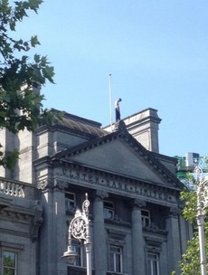 Man who spent over four hours on six-storey Dame Street building taken away safely