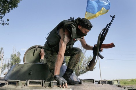 File phot of a Ukrainian soldier taking position during a battle with pro-Russian separatist fighters outside Slovyansk