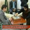 Checkmates: Colonel Gaddafi plays chess with renowned Russian eccentric