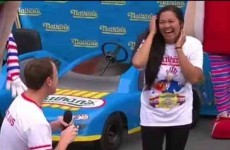 Champ Joey Chestnut proposes to girlfriend, eats 61 hot dogs, wins Nathan's contest