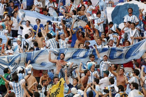 Argentina fans celebrate at the end of the World Cup quarter-final match.