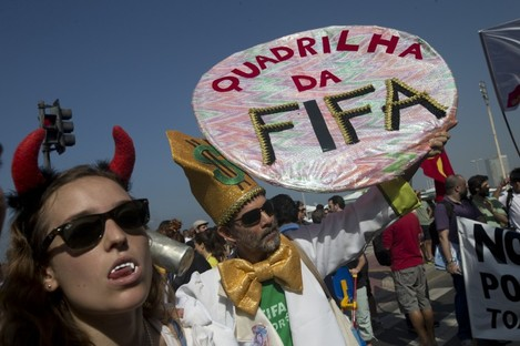 'FIFA gang' reads one protester's sign.