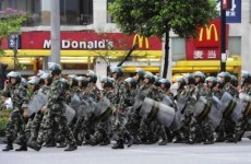 Chinese forces restore calm after weekend of rioting