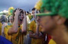 7 pictures of distraught Brazil fans, 1 of Heidi Klum celebrating