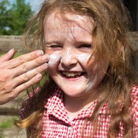 Is spraying sun cream on our kids doing them more harm than good?